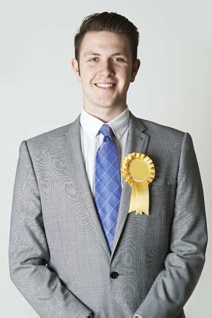 congressman: Portrait Of Politician Wearing Yellow Rosette Stock Photo