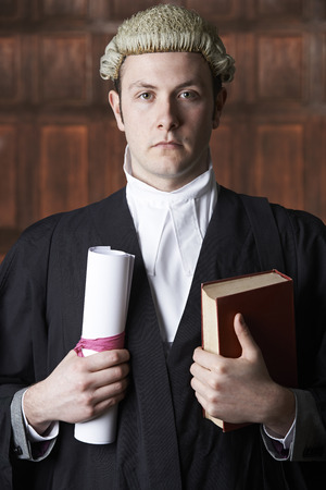 divorce court: Portrait Of Male Lawyer In Court Holding Brief And Book