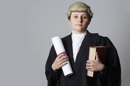 defendant: Studio Portrait Of Female Lawyer Holding Brief And Book