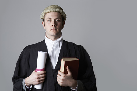 libel: Studio Portrait Of Lawyer Holding Brief And Book