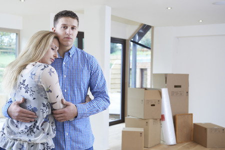 packing: Young Couple Forced To Move Home Through Financial Problems Stock Photo