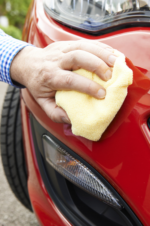 valet: Close Up Of Hand Polishing Car Using Cloth