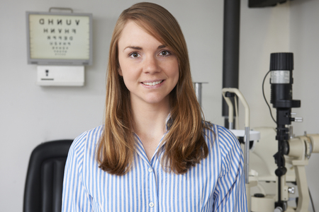 optician: Portrait Of Female Optician In Optometrists