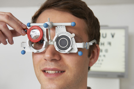 optometrist: Man Having Sight Test At Optometrist