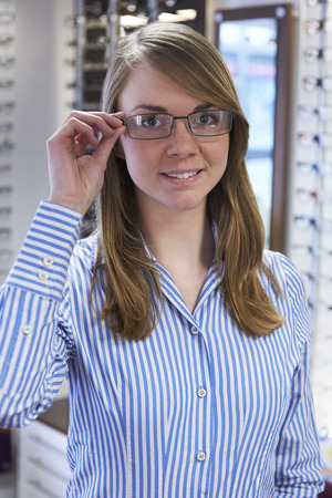 woman  glasses: Woman Trying On Glasses In Opticians