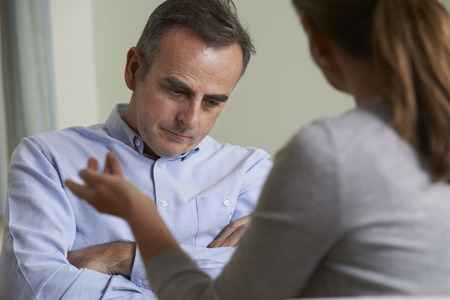 two person: Depressed Mature Man Talking To Counsellor