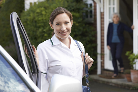 adult care: Female Care Worker Visiting Senior Woman At Home