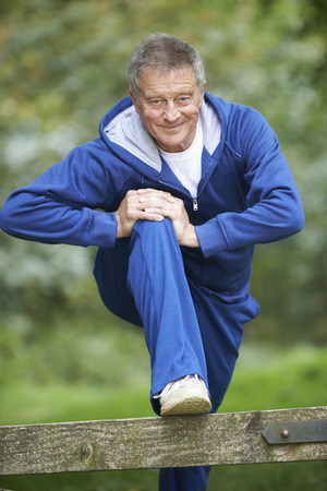 tracksuit: Senior Man Stretching On Countryside Run