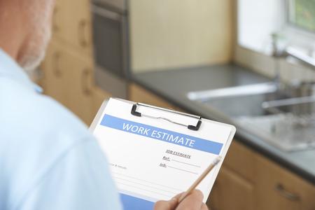 home builder: Builder Preparing Estimate For Home Improvement