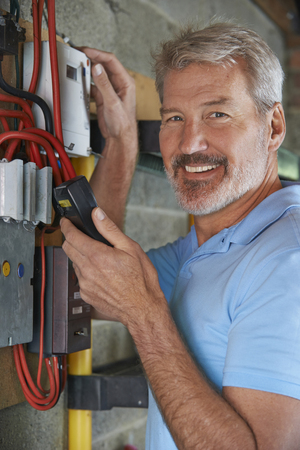 electricity meter: Portrait Of Man Taking Electricity Meter Reading