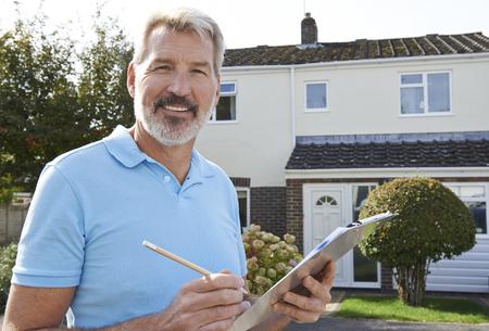 roof windows: Builder Preparing Estimate For Exterior Home Improvement