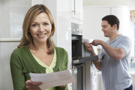 happy customer: Satisfied Female Customer With Oven Repair Bill