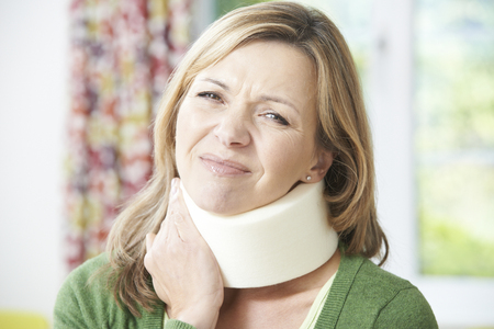 neck injury: Woman Reading Letter After Receiving Neck Injury