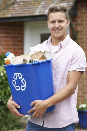 recycling bin: Portrait Of Man Carrying Recycling Bin