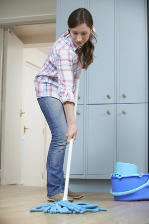 cleaning kitchen: Woman Cleaning Kitchen Floor With Mop