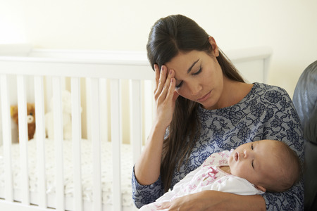 exhausted: Tired Mother Suffering From Post Natal Depression