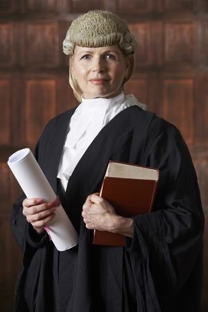 court: Portrait Of Female Lawyer In Court Holding Brief And Book