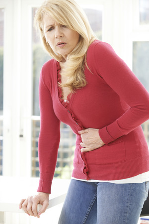 stomach: Mature Woman Suffering From Stomach Pain At Home