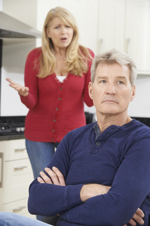 two couples: Mature Couple Having Arguement At Home
