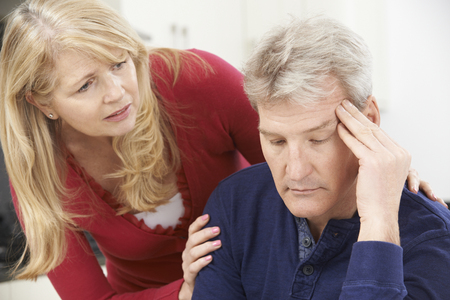 grief: Mature Woman Comforting Man With Depression