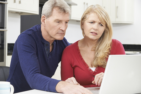 sadness: Worried Mature Couple Reviewing Domestic Finances
