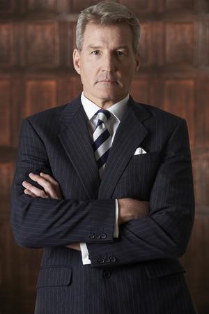 traje formal: Portrait Of Mature Businessman In Boardroom