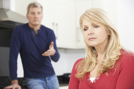middle aged man: Mature Couple Having Arguement At Home