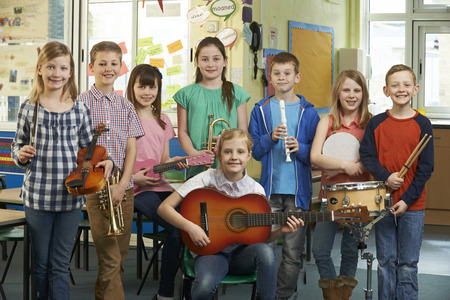 students fun: Portrait Of Students Playing In School Orchestra Together Stock Photo