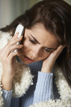 sick leave: Ill Woman Phoning In Sick To Work On Mobile Phone Stock Photo
