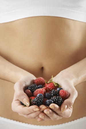 berries: Close Up Of Woman In Underwear Holding Fresh Summer Berries