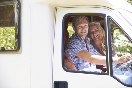 motor home: Couple Driving Motor Home On Vacation Stock Photo