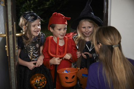 trick or treating: Halloween Party With Children Trick Or Treating In Costume