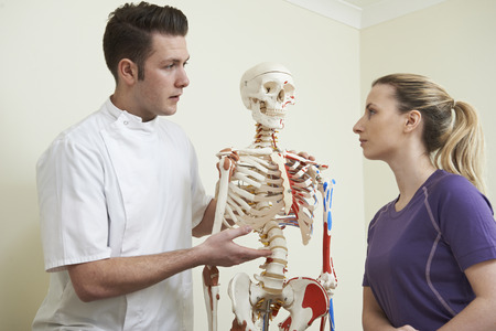 osteopath: Female Patient In Consultation With Osteopath