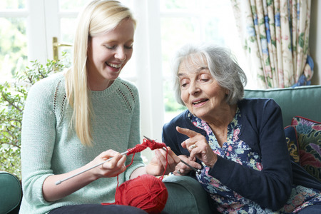 19 years old: Grandmother Showing Granddaughter How To Knit