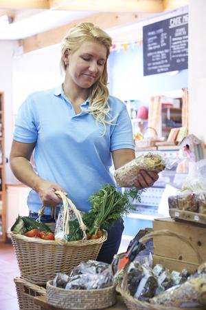 farm shop: Female Customer Shopping In Farm Shop