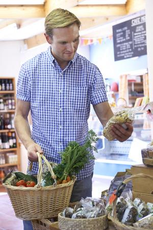farm shop: Male Customer Shopping In Farm Shop Stock Photo