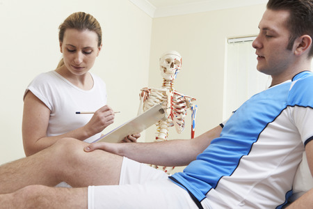 osteopath: Male Patient Describing Sports Injury To Osteopath