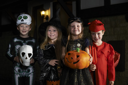 scary halloween: Halloween Party With Children Trick Or Treating In Costume