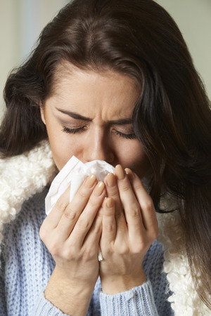 sneezing: Woman With Cold Holding Tissue And Sneezing