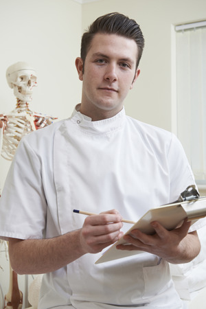 osteopath: Portrait Of Osteopath In Consulting Room