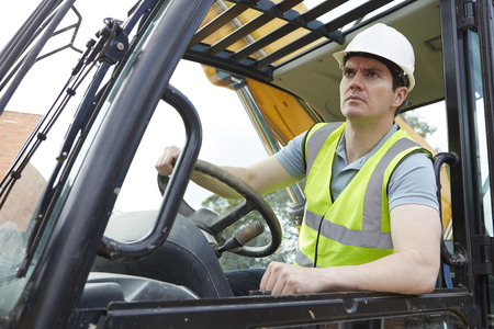 construction site: Construction Worker Driving Digger