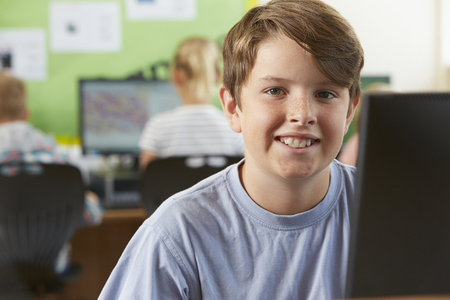 child portrait: Male Elementary School Pupil In Computer Class Stock Photo
