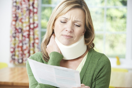 at home accident: Woman Reading Letter After Receiving Neck Injury