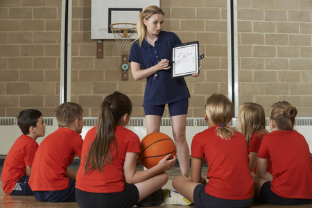 9 ball: Coach Giving Team Talk To Elementary School Basketball Team