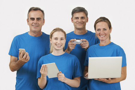 office uniform: Studio Portrait Of IT Support Staff Wearing Uniform Against White Background Stock Photo