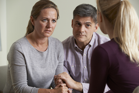 arguement: Mature Couple Talking With Counsellor