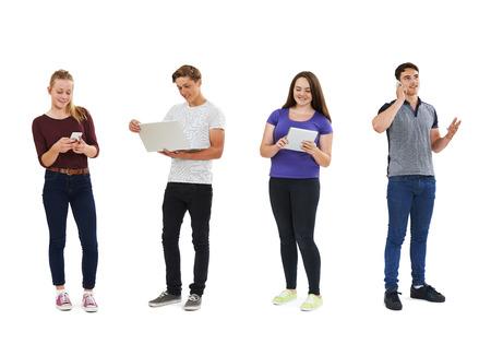 browsing: Studio Shot Of Teenagers Using Communication Technology
