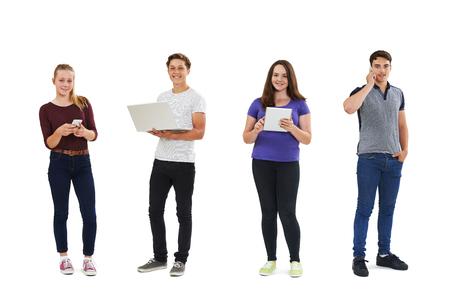 background person: Studio Shot Of Teenagers Using Communication Technology