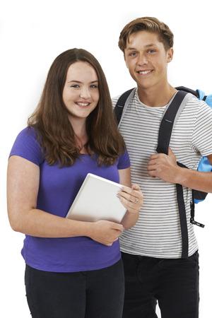 standing together: Studio Portrait Of Teenage Student Couple
