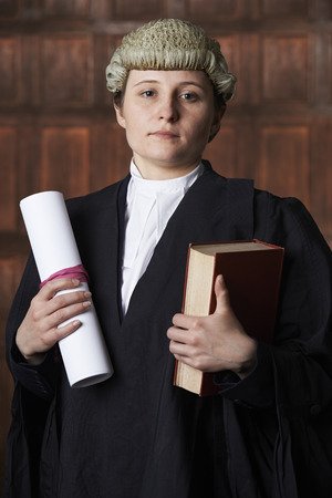 libel: Portrait Of Lawyer In Court Holding Brief And Book